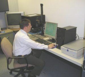 Entering suspect data into fingerprint system.